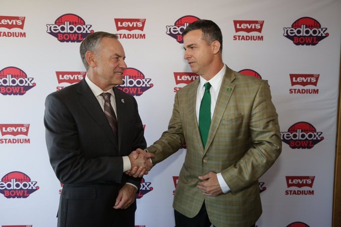 Redbox_bowl_press_conference_coaches_shaking_hands.jpg?preset=large